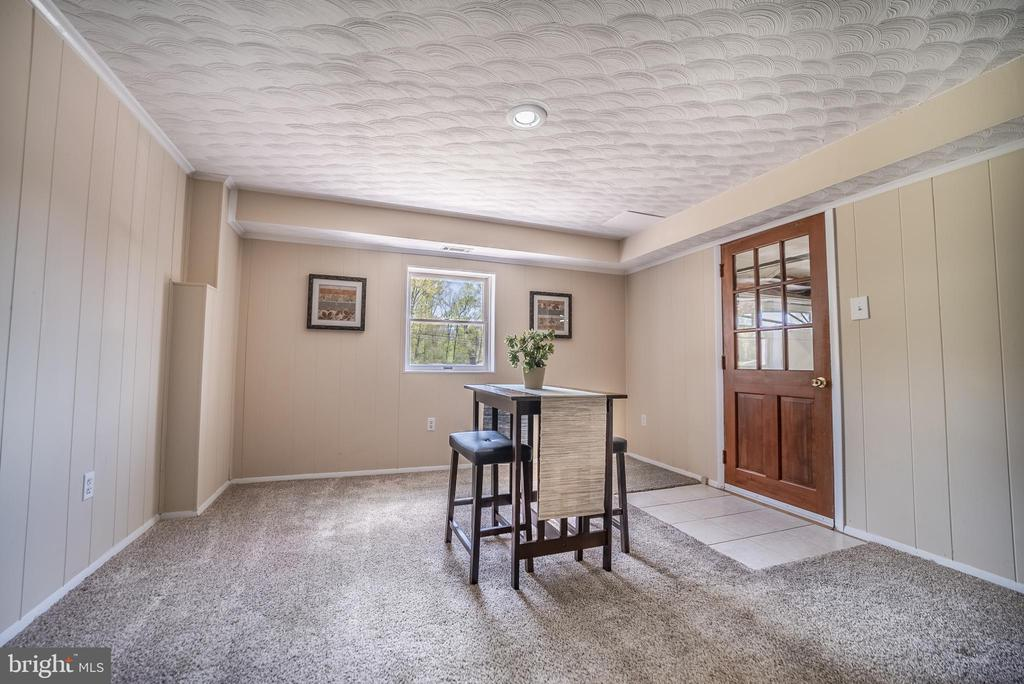1st Lower Level Family Room W/Garage Entrance - 3506 W WATERSVILLE RD, MOUNT AIRY
