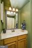Half bath on main with designer mirror & fixture - 6510 WESTMORE CT, SPRINGFIELD