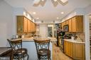 Breakfast bar with custom tile finish & backsplash - 6510 WESTMORE CT, SPRINGFIELD