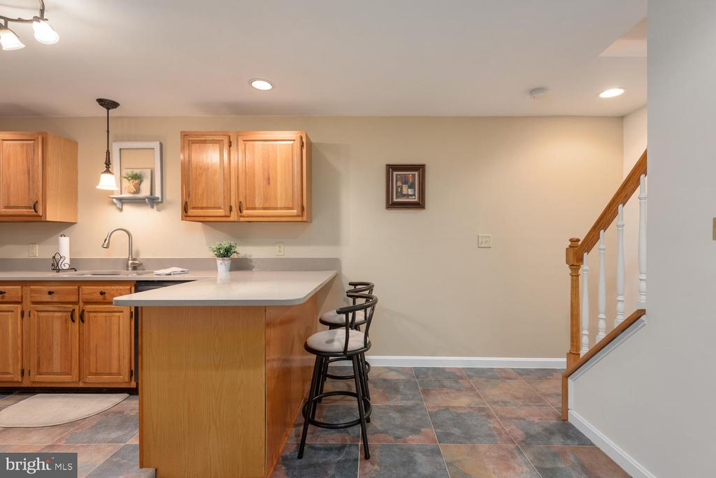Lower level has breakfast bar and slate flooring. - 325 SANDY RIDGE RD, FREDERICKSBURG