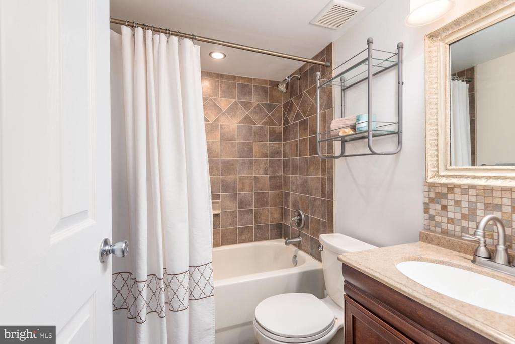 Lower level bath upgraded with new tile. - 325 SANDY RIDGE RD, FREDERICKSBURG