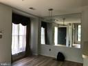 Dining room has been painted light gray. - 9812 SPANISH OAK WAY #118, BOWIE