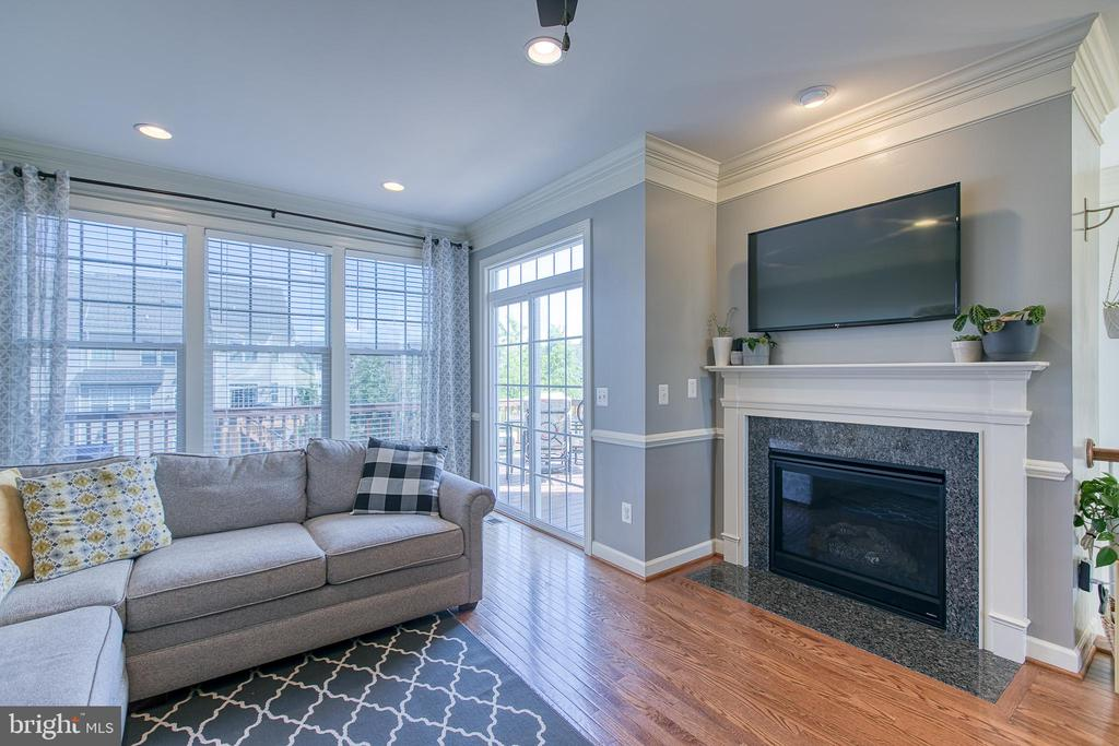 Plenty of natural light and cozy gas fireplace. - 214 WOODSTREAM BLVD, STAFFORD