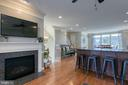 Living room off deck & kitchen with gas fireplace. - 214 WOODSTREAM BLVD, STAFFORD
