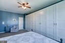 Master bedroom with ceiling fan and large bathroom - 214 WOODSTREAM BLVD, STAFFORD