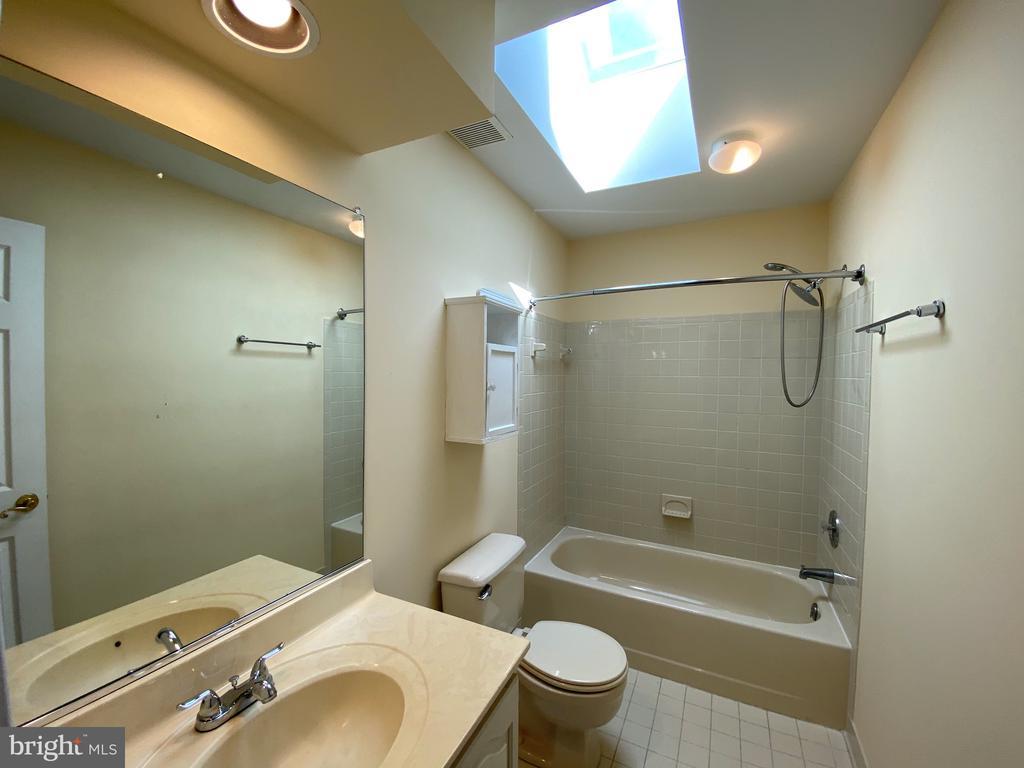 Hall Bath with skylight - 1401 HUNTING WOOD RD, ANNAPOLIS