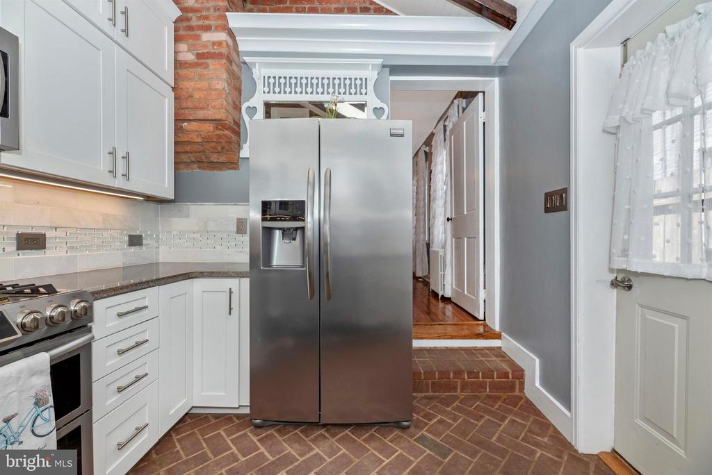 Brick flooring, upgraded stainless appliances - 137 W 3RD ST, FREDERICK
