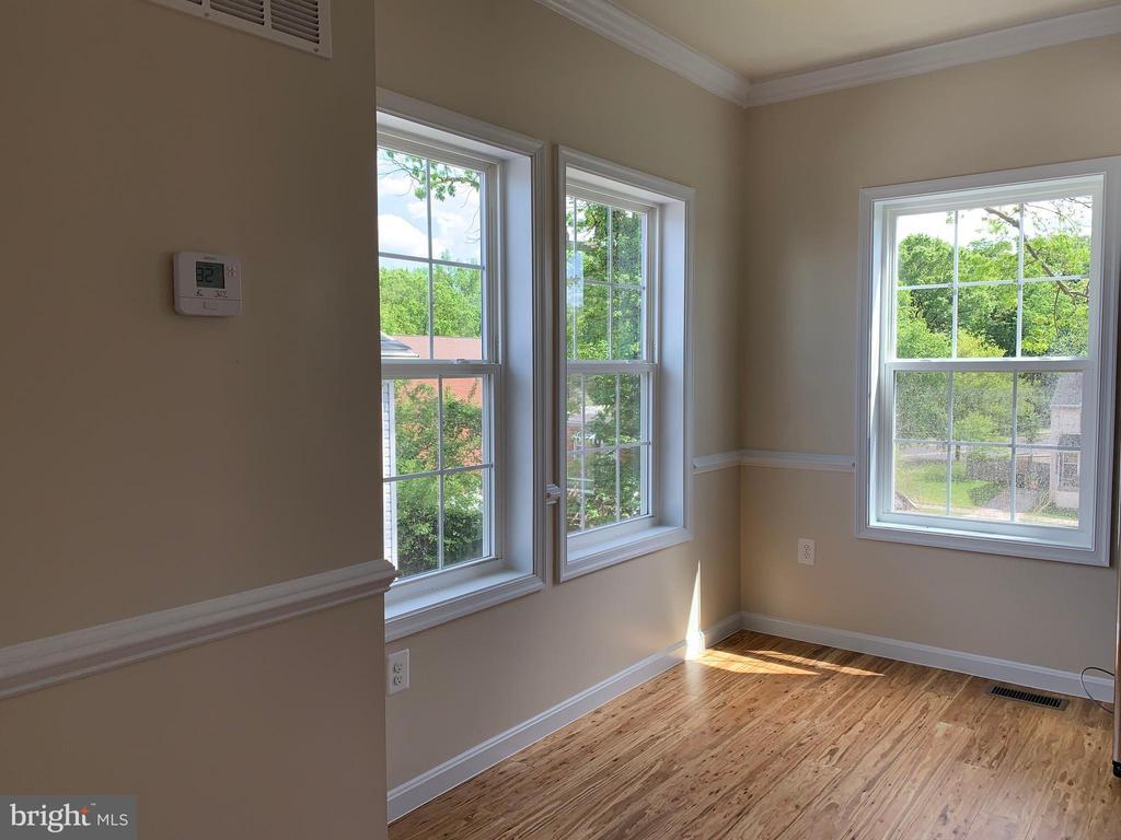 Kitchen with breakfast nook has three windows - 5509 C ST SE, WASHINGTON