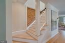 Wide stairs with skylight and brick exposed - 517 13TH ST NE, WASHINGTON