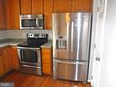 Kitchen, SS appliances, Silestone countertops - 12062 ETTA PL, BRISTOW