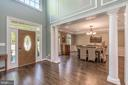 Grand two-story foyer with detailed moldings - 5400 LIGHTNING DR, HAYMARKET