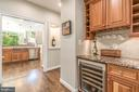 Butlers pantry with view of kitchen - 5400 LIGHTNING DR, HAYMARKET