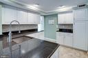 Kitchen with Recessed Lighting and Crown Molding - 1542 DEER POINT WAY, RESTON
