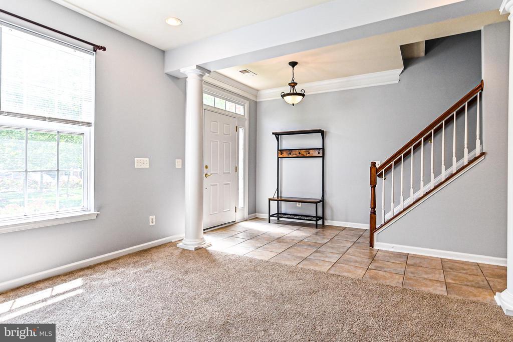 Stairs going up to half bath, kitchen & living - 22944 ROSE QUARTZ SQ, BRAMBLETON