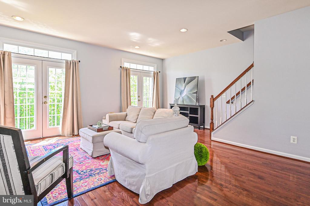Living area with stairs to bedrooms - 22944 ROSE QUARTZ SQ, BRAMBLETON