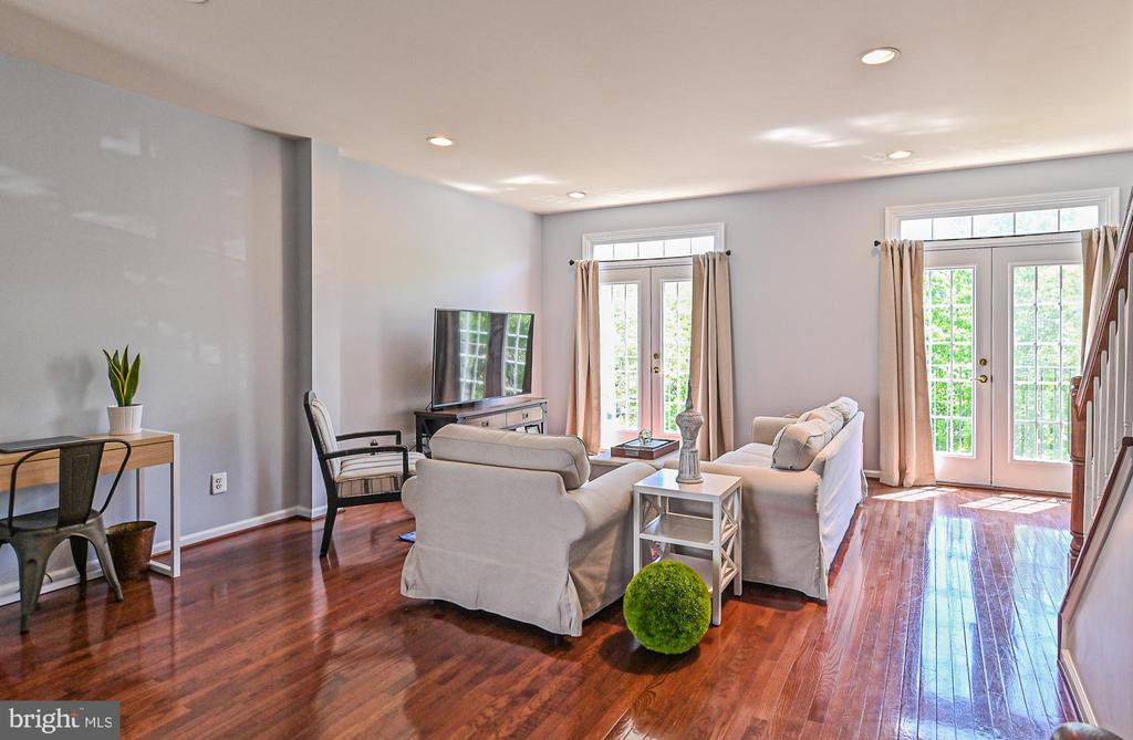 Living room with French doors opening to outside - 22944 ROSE QUARTZ SQ, BRAMBLETON