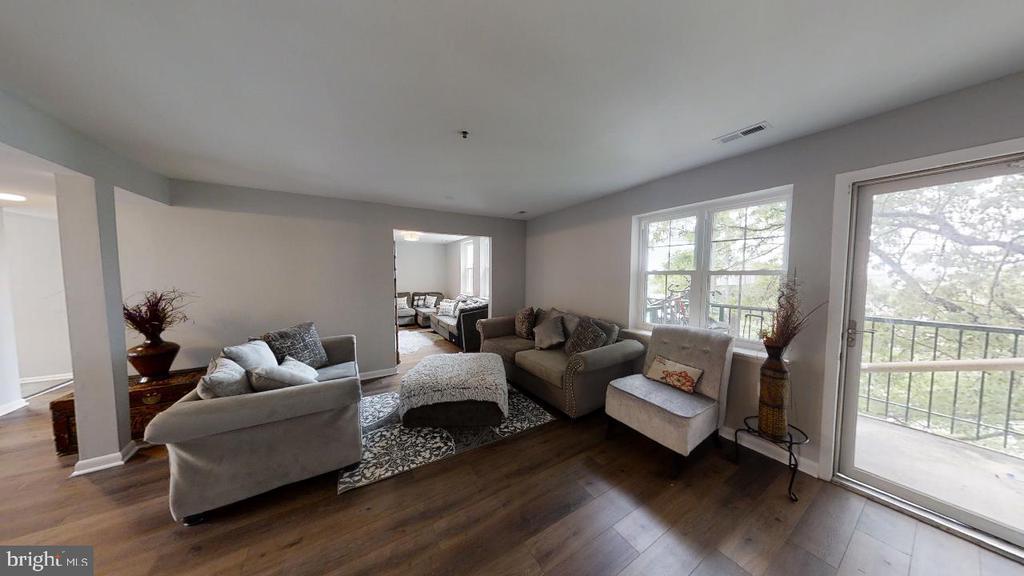 Living room with balcony - 2318 18TH ST NE #2318, WASHINGTON