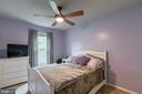 Bedroom 2 with ceiling fan. - 12153 STALLION CT, WOODBRIDGE