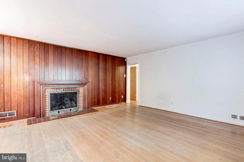 Living area with fireplace - 4625 EDGEFIELD RD, BETHESDA