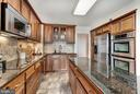 Spacious Kitchen with Granite and Stainless Steel - 1600 N OAK ST #1010, ARLINGTON