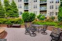 barely a view of the condo balcony from courtyard - 12001 MARKET ST #177, RESTON