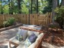 Back deck with hardscapes, firepit and privacy - 5508 KENDRICK LN, BURKE