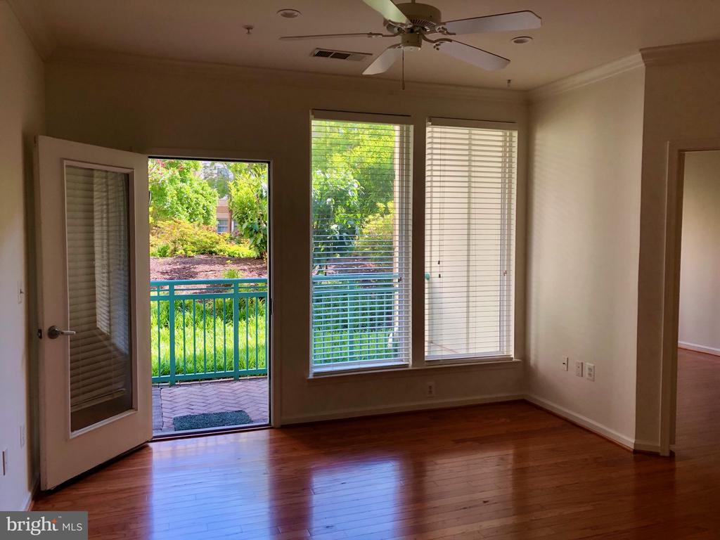 living room opens to balcony - 12001 MARKET ST #177, RESTON