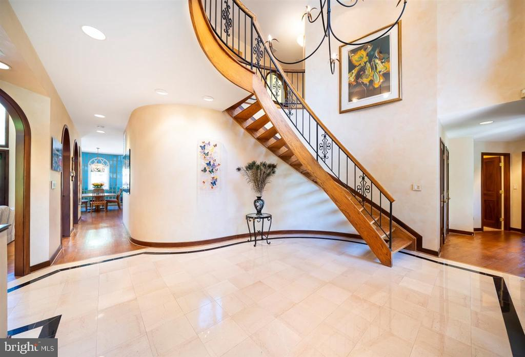 Custom wrought iron railings ascend with stairs - 6072 WHITE FLINT DR, FREDERICK