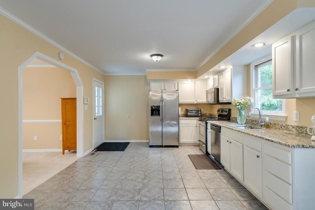 Updated cabinetry and stainless appliances. - 1065 MOUNTAIN VIEW RD, FREDERICKSBURG