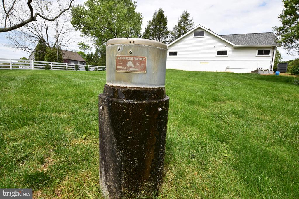 Side Yard with Horse Trough - 3001 GILLIS FALLS RD, MOUNT AIRY