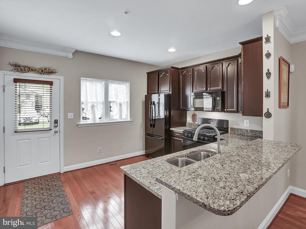 Kitchen with Breakfast Bar - 27 LORD NICKENS ST, FREDERICK