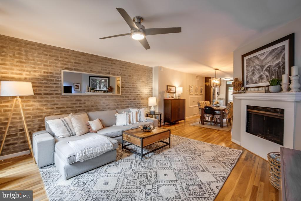 Family room exposed brick and wood fireplace - 363 N ST SW #363, WASHINGTON