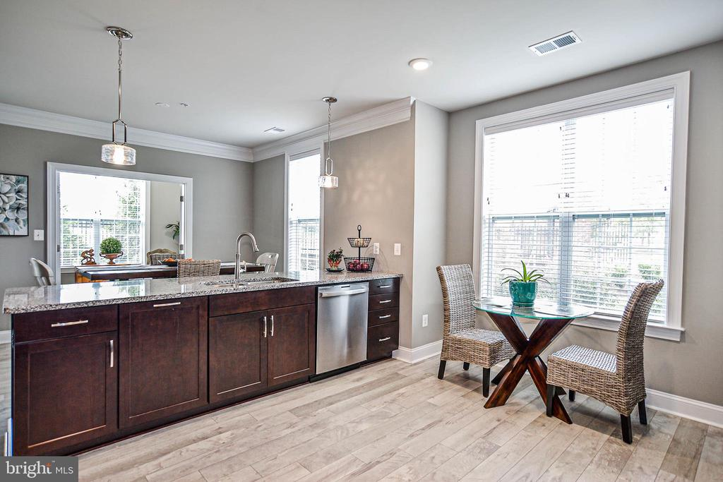 Sit at the breakfast table and enjoy the outdoors. - 20981 ROCKY KNOLL SQUARE #107, ASHBURN