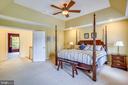 Master bedroom suite with ceiling fan - 206 WATKINS CIR, ROCKVILLE