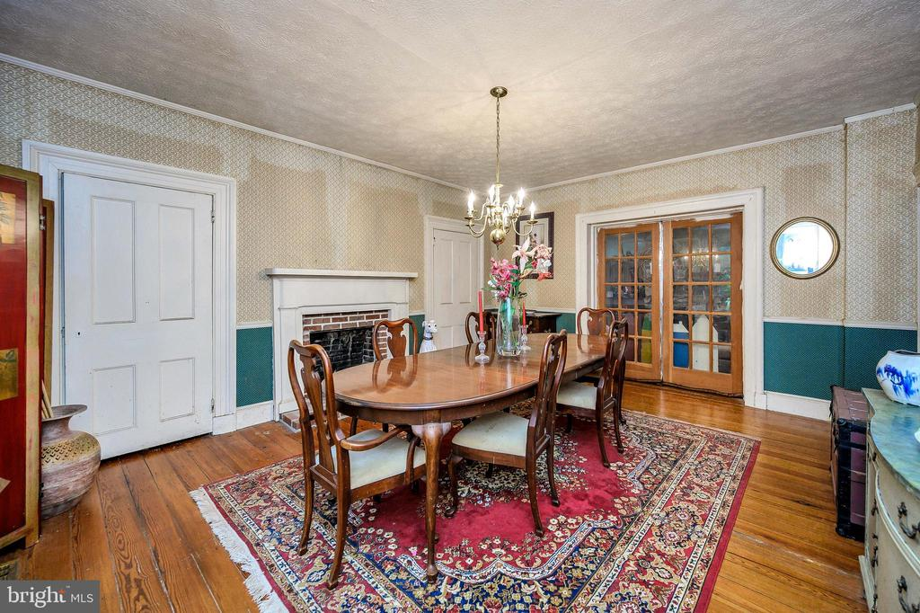 Formal dining room with fireplace - 16253 MARQUIS RD, ORANGE
