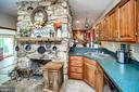 Floor to ceiling stone fireplace - 16253 MARQUIS RD, ORANGE