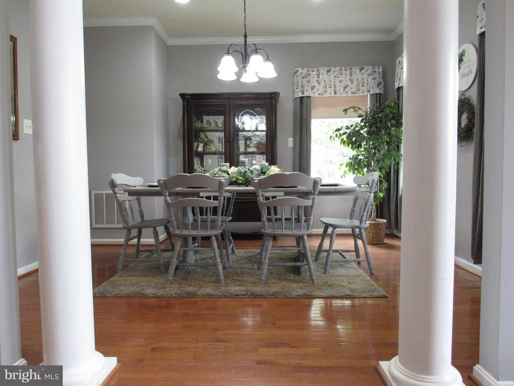 1st floor: formal dining room with hardwood floors - 27 CAPE COD, MARTINSBURG