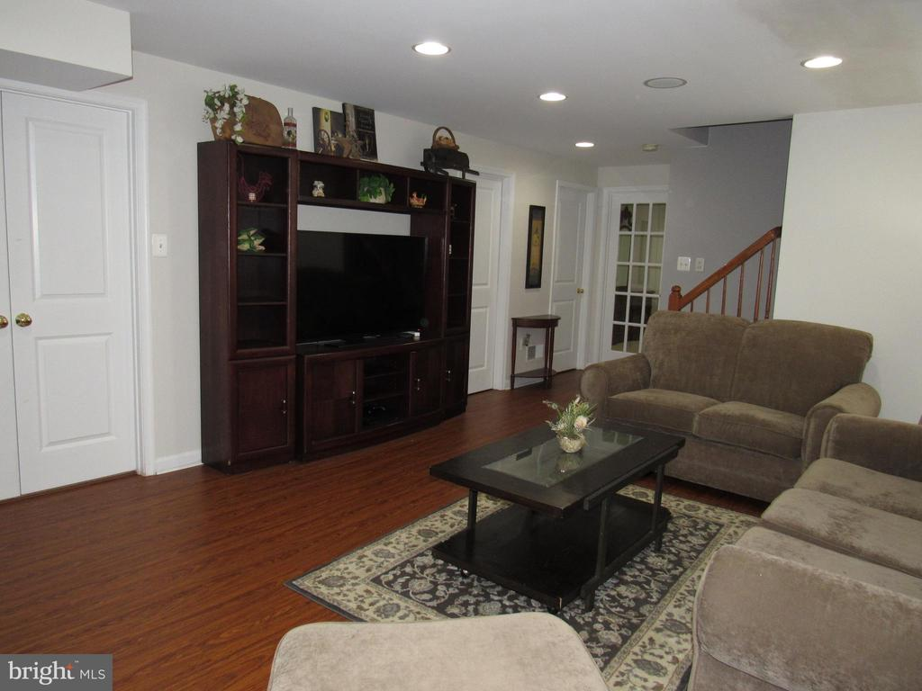 Basement:: Family room with new flooring - 27 CAPE COD, MARTINSBURG