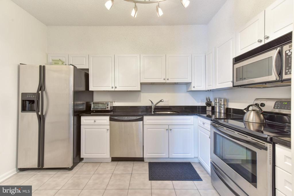 White Contemporary Cabinetry..Sparkling Tile Floor - 3800 POWELL LN #PH 30, FALLS CHURCH