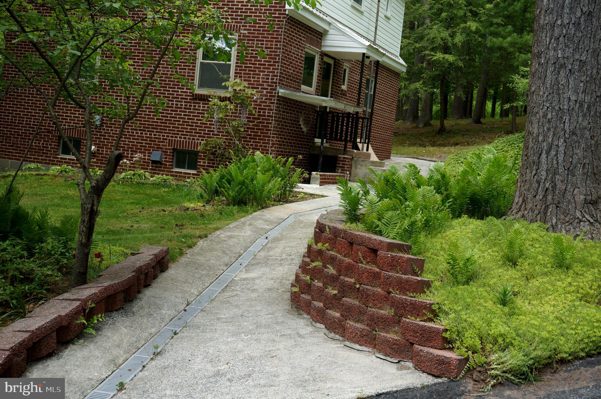Concrete Rear Sidewalk with Built-in Drainage