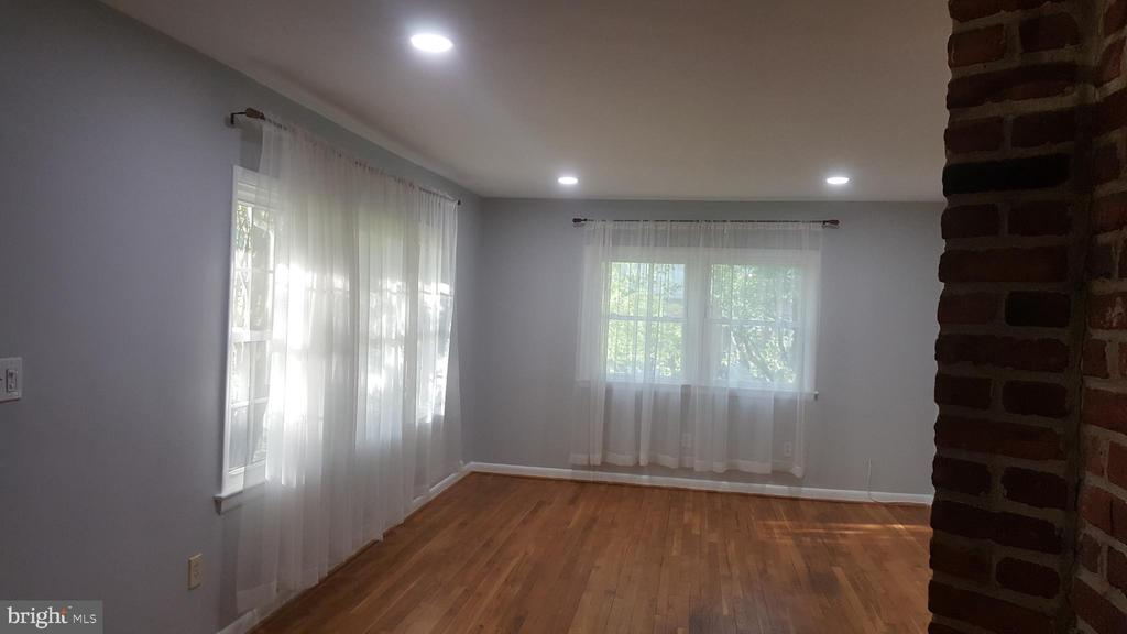 Living room with recessed lights  and large window - 6216 STONEHAM RD, BETHESDA