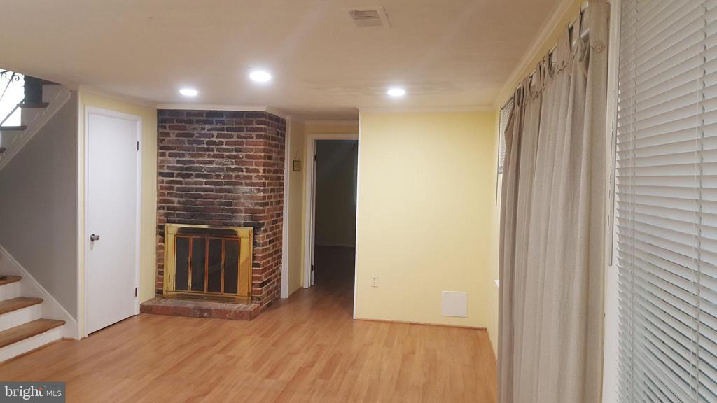 Family room with Fireplace and recessed lights - 6216 STONEHAM RD, BETHESDA