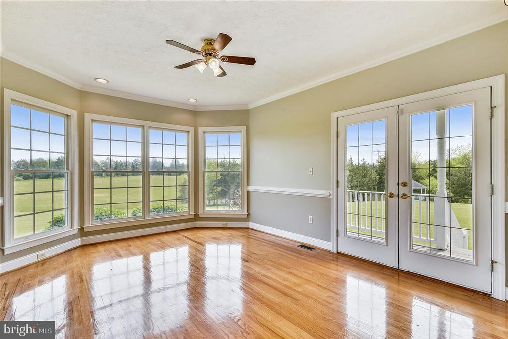 Living room opens to side porch and beautiful view - 2040 SALEM CHURCH RD, STEPHENS CITY