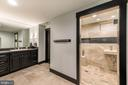 Expanded lower level bath with steam room - 15609 RYDER CUP DR, HAYMARKET