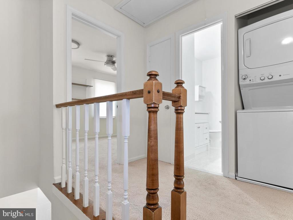 Stacked washer/dryer greets you upstairs. - 1030-B MARGATE CT, STERLING