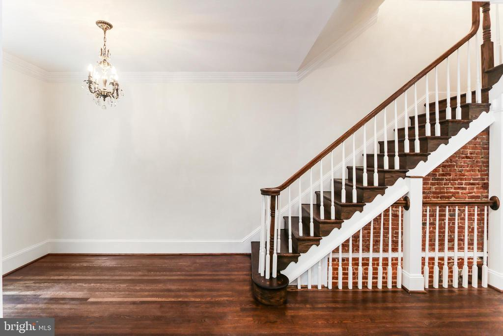 Full width Insulated stairs leading upstairs - 2705 WOODLEY RD NW, WASHINGTON