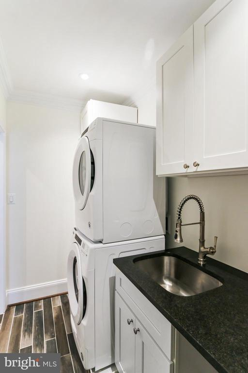 Laundry room has tiled floor and sink - 2705 WOODLEY RD NW, WASHINGTON
