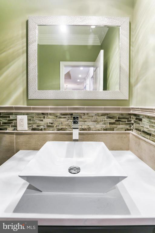 Modern Powder room; completes the first floor - 2705 WOODLEY RD NW, WASHINGTON