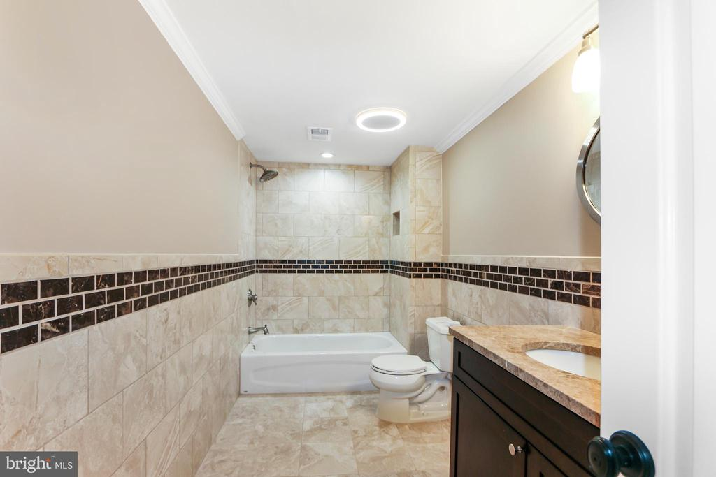 Large full bath in basement with heated floors - 2705 WOODLEY RD NW, WASHINGTON