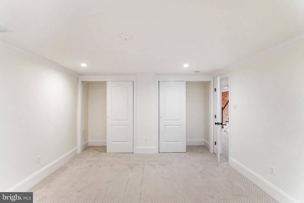 Full width closet with sliding doors. - 2705 WOODLEY RD NW, WASHINGTON